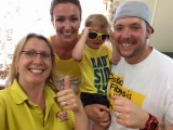 Gabriel and his parents and Rhythm Time teacher on Wear Yellow Day